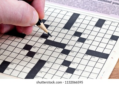 A player about to begin filling in a word on a crossword puzzle