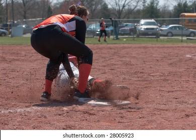 player applies tag to sliding runner at third base
