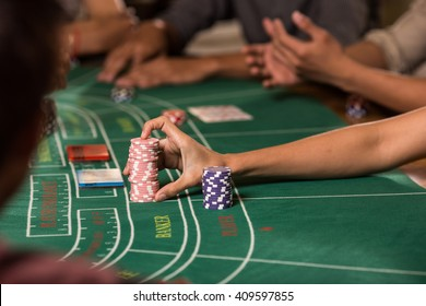 Player bet baccarat with hand and chips