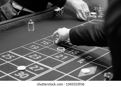 The player bets on the gaming table in the casino.