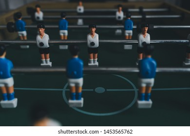 the player of defense versus player Striker a concept business offenses with soccer table