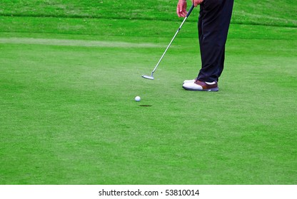 Player finishing the game (putting ball in the hole)