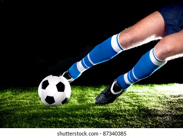 player hits the ball with his foot on the football field