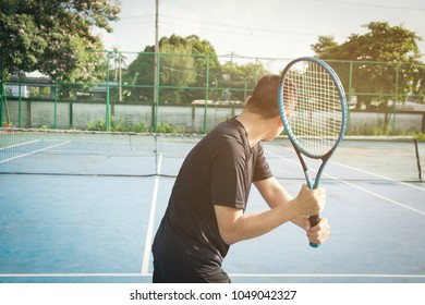 player hold  racket in hand preparing to serve ball during match.sport outdoor concept