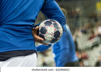Player holding the ball, close up