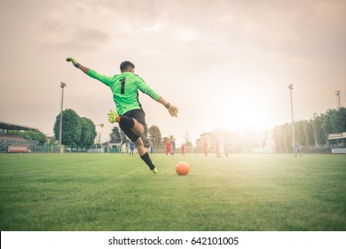 Player kicking the ball