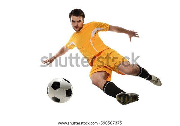 Player kicking soccer ball isolated over white background