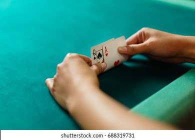 Player peeking cards in Blackjack game
