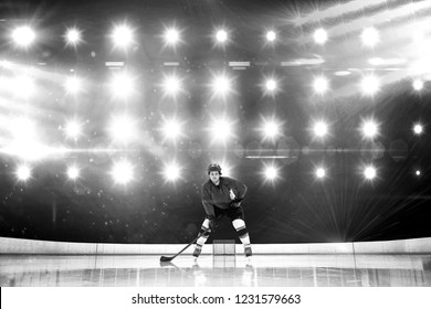 Player playing ice hockey against composite image of blue spotlight