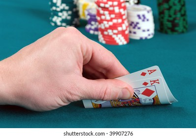 The player slightly opens cards, an as of diamonds and the king.