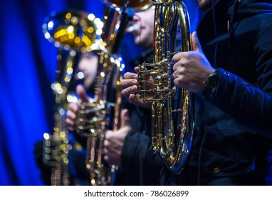 Players in concert tuba, Tuba brass instrument. Wind musical instruments