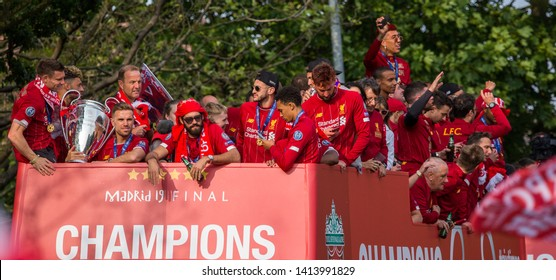 The players and management of Liverpool Football Club seen on an open top bus parading the Champions League trophy through the streets of Liverpool on 2 June 2019.