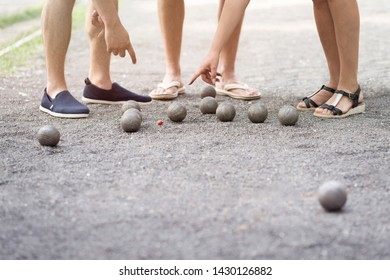 Players measure distance in petanque boule french game find out who is winner