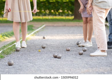 Players measure distance in petanque boule french game