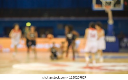 Players play basketball, the image is blurred