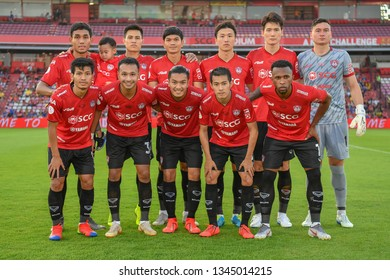 Players of SCG Muangthong United shot photo during The Football Thai League match between SCG Muangthong United and PT Prachuap F.C.at SCG Stadium on February24,2019 in Nonthaburi,Thailand