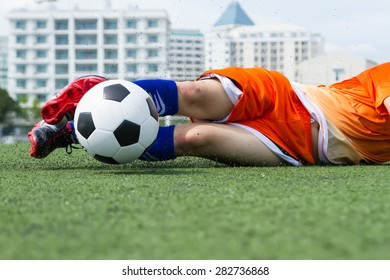 Players Soccer balls are sliding on the turf.