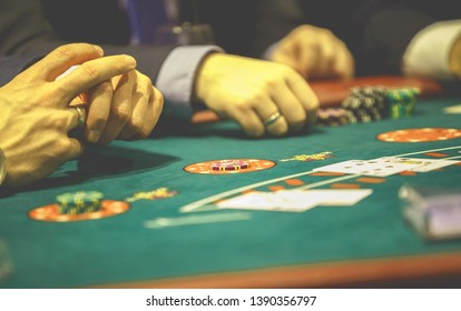 players at the table playing Texas hold'em