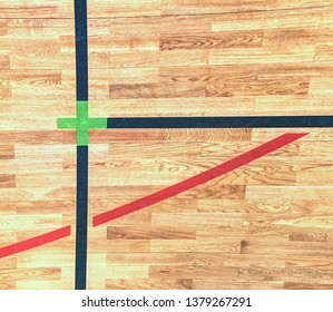 Playfield lines painted on renewal gymnasium wooden floor. Inside athletic playground