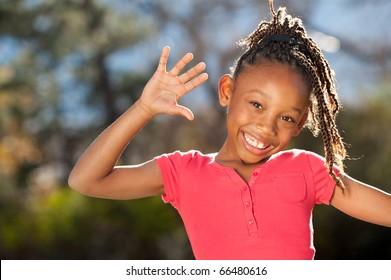 Playful African American girl enjoying nice sunny day