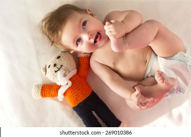 Playful baby lying with a diaper