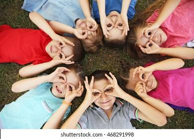 Playful children lying on grass