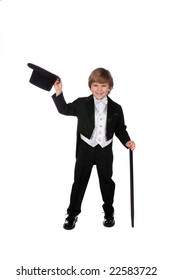 playful and cute young boy in tux lifting off his top hat