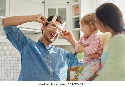 Playful family with baby spending time together