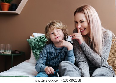 Playful family. Happy young mother having fun with her son