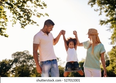 Playful family having fun outdoors and walking