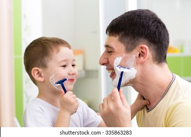 playful father and kid son shaving together at home bathroom