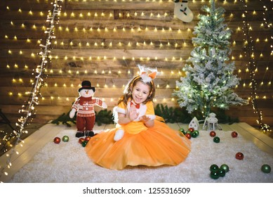 playful girl dancing in fox dress in wooden room with lights