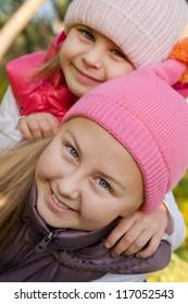 playful girls in autumnal park