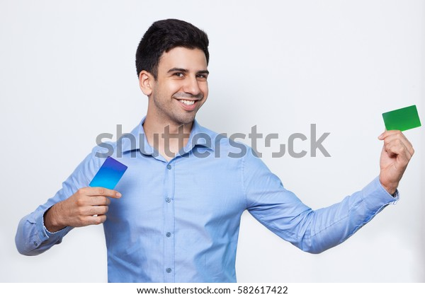 Playful Handsome Man Showing Two Credit Cards