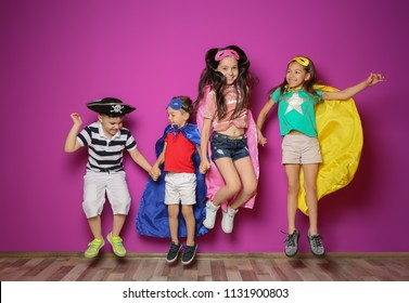 Playful little children in cute costumes indoors