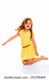 playful little girl in yellow dress