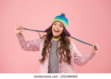 Playful mood. Accessory protect head. Adorable small child wear knitted accessory. Cute little girl with fashion accessory pink background. Trendy stylish accessory. Kids hats for winter season.