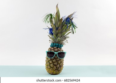 e2efee712ce4 Playful pineapple wearing sunglasses and palm cocktail on a pop bi-color  background turquoise and