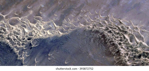 playful seals in sea of dunes on waves in the desert,abstract photography of the deserts of Africa from the air, bird's eye view, abstract expressionism, contemporary art, optical illusions,