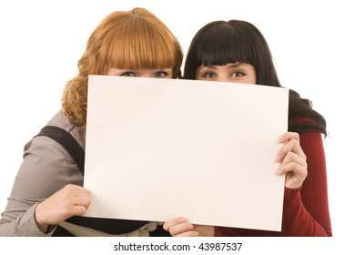 Playful young business colleague pointing the blank white board on isolated background