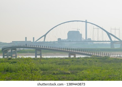 The playfully meandering concrete Zaligebrug pedestrian bridge across the new river channel in the floodplains of the river Waal near Nijmegen, The Netherlands