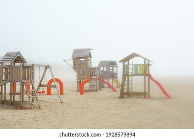 Playground by the sea. Thick fog.