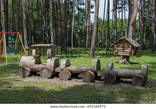 Playground for children in the Park. Wooden equipment hut and train.