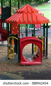 Playground equipment in garden setting