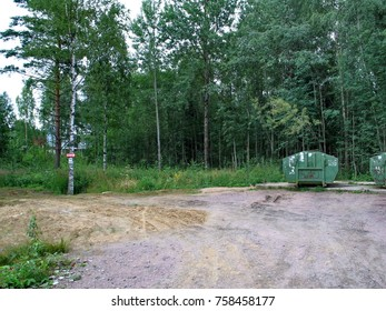 playground with garbage cans in the middle of the forest