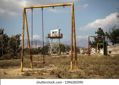 A playground located in a border park of  Nicosia, Cyprus, September 15, 2016. The UN watchtower is seen in the Buffer Zone (rear) and Troodos mountains in the back most.