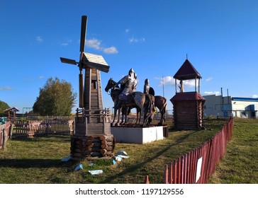 A playground in the park with sculptures of three horsemen, a mill and a belfry from Russian epics, three heroes.