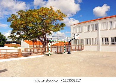 Playground of a public school with basketball court