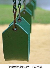 Playground swings in a row
