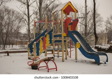 Playground in winter. Winter is a nuisance for children. The snow on the playing apparatus.